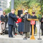 Mayor Kip Holden giving the first donation of the 2014 Red Kettle Season.